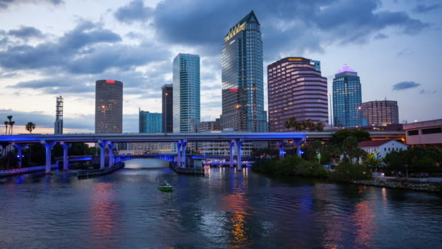 downtown tampa, florida day to night city skyline time lapse (logos and faces blurred) - twilight stock videos & royalty-free footage