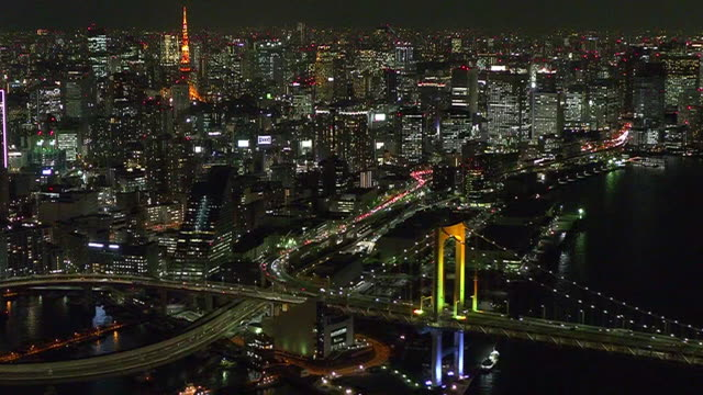 aerial, downtown tokyo with rainbow bridge and tokyo tower, japan - tokyo bay stock videos & royalty-free footage