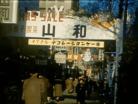 1953 mg downtown tokyo with store signs in street / tokyo, japan - lingua giapponese video stock e b–roll