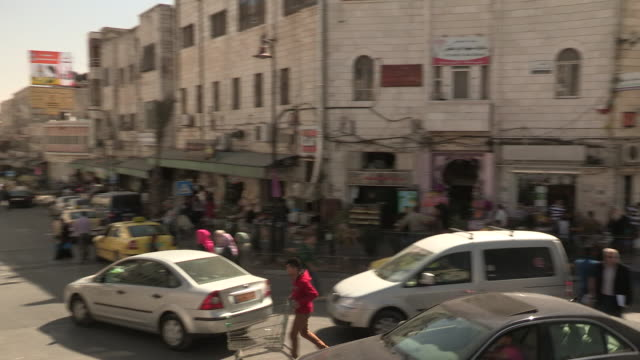 downtown traffic, ramallah, palestine - ramallah stock videos and b-roll footage