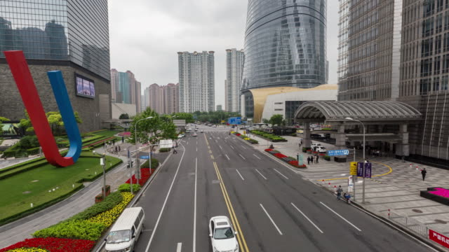 downtown traffic/shang hai, china - shanghai world financial center stock videos & royalty-free footage