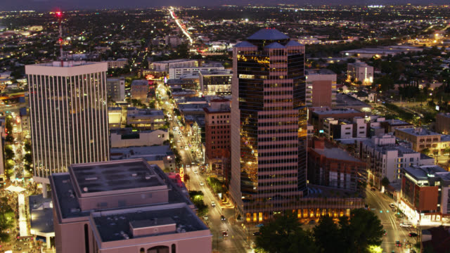 downtown tucson lit up at night - drone shot - arizona stock videos & royalty-free footage