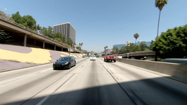 la downtown v synced series rear view driving process plate - rear view stock videos & royalty-free footage