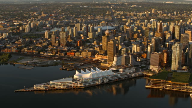 AERIAL Downtown Vancouver and Canada Place at sunrise
