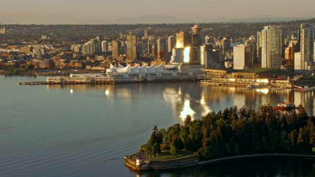 aerial downtown vancouver and canada place at sunrise - vancouver canada stock videos and b-roll footage
