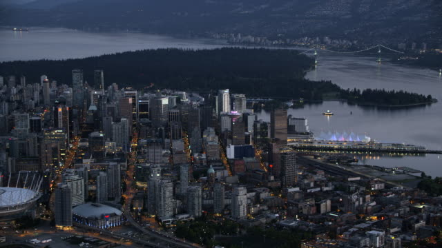 AERIAL Downtown Vancouver with Vancouver Harbour and False Creek at dusk