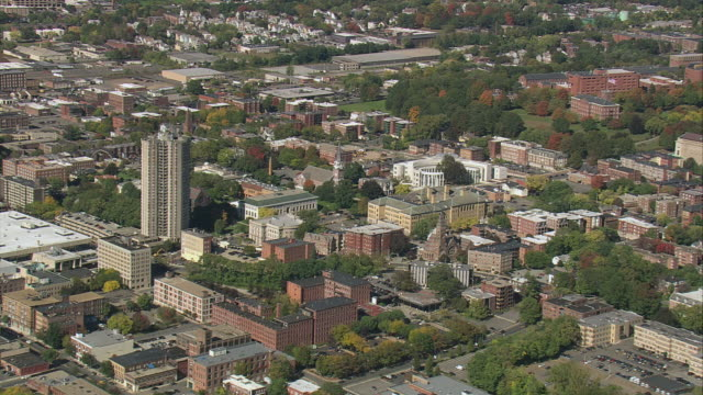 aerial downtown with commercial buildings, historic industrial area, and trees / springfield, massachusetts, united states - springfield massachusetts stock videos & royalty-free footage