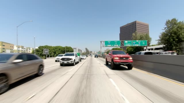 la downtown xxxiii synced series rear view driving process plate - multiple lane highway stock videos & royalty-free footage
