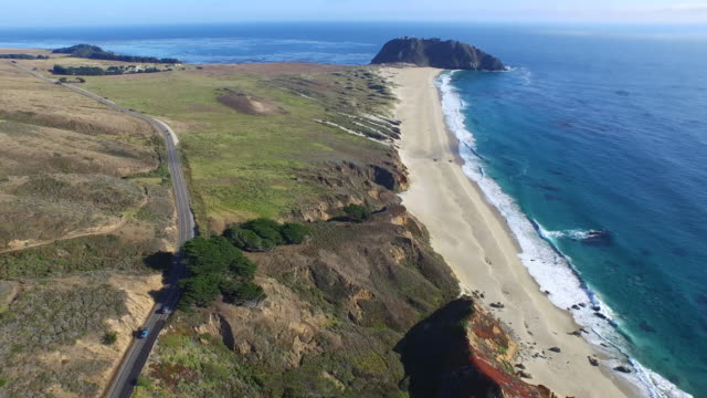 downward aerial high reveal: 4k uhd highway 1 and point sur shp - route 001 stock videos & royalty-free footage
