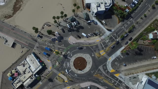 downward aerial hover reveal: santa cruz roundabout - santa cruz california stock videos and b-roll footage