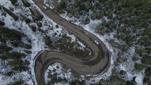 downward aerial tilt up reveal: emerald bay sp - winding road stock videos & royalty-free footage