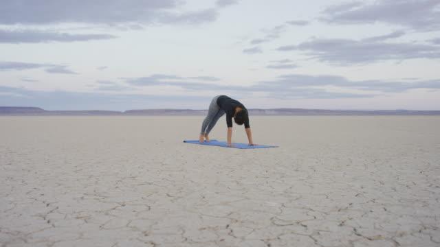 Downward dog pose in the desert