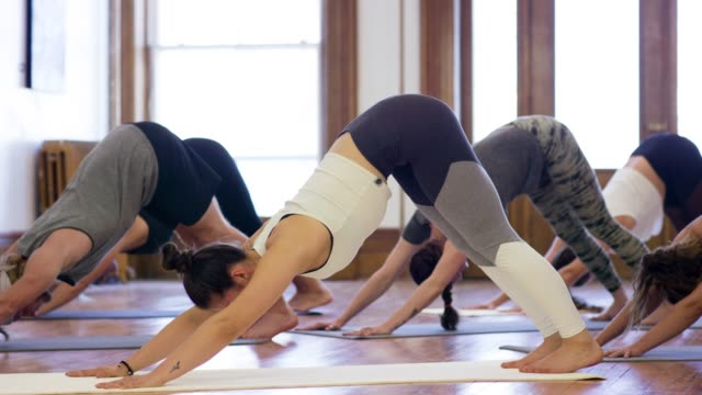 downward dog - posture stock videos & royalty-free footage