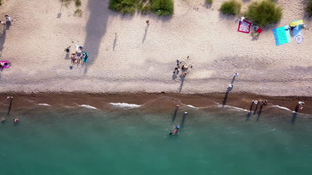 downward looking view of the beach at port huron michigan near the canadian border - michigan stock videos & royalty-free footage
