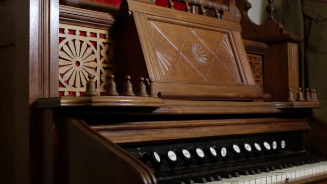 Downward pan of old organ