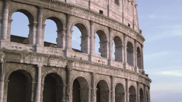 downward tilt from tip of colosseum to the arch of constantine - arch of constantine stock videos and b-roll footage