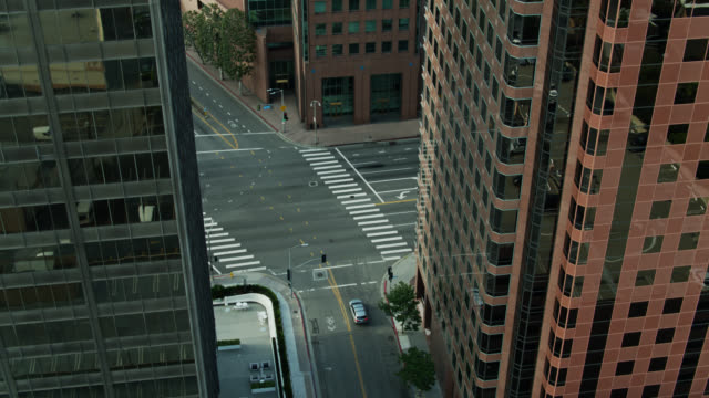 downward tilting drone shot of wilshire and westwood blvds in los angeles - westwood neighborhood los angeles stock videos & royalty-free footage