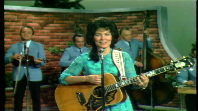 """doyle wilburn introduces loretta lynn who performs """"you ain't woman enough"""" with backing by the wilburn brothers show band featuring buddy spicher on... - country and western stock videos and b-roll footage"""