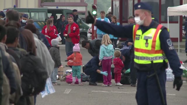 dozen buses provided by the croatian government arrive at the hungarian border with over 600 migrants on board - eastern european culture stock videos & royalty-free footage