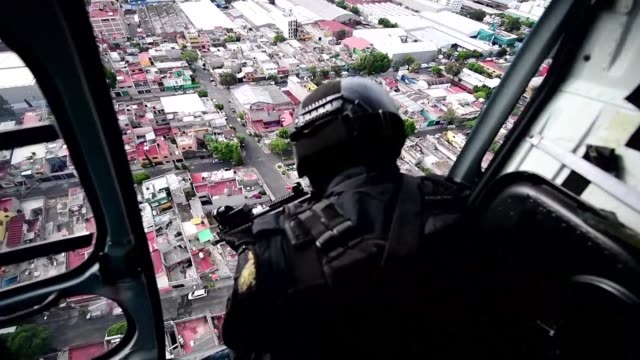 dozen of police helicopters fly over mexico city every day to monitor security - dozen stock videos & royalty-free footage