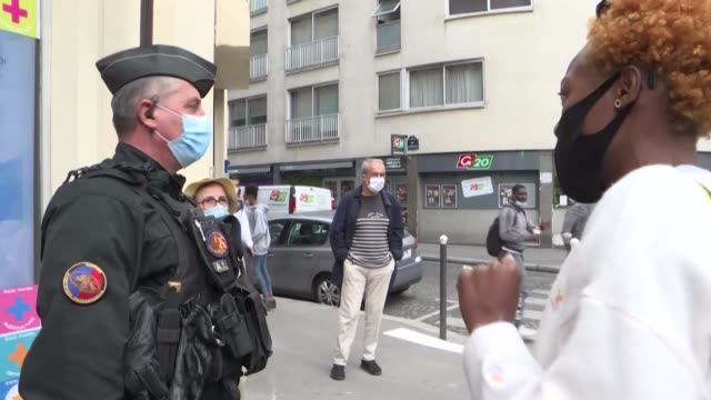 """dozen people attempt to demonstrate in front of the headquarters of the magazine valeurs actuelles to protest against the publication of a """"political... - publication stock videos & royalty-free footage"""
