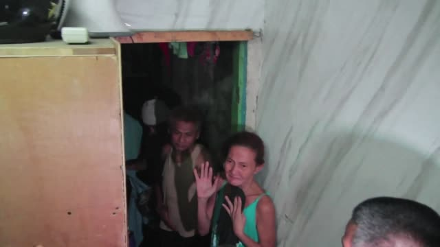 stockvideo's en b-roll-footage met a dozen people have been found stuffed inside a closetsized cell hidden behind a book shelf in a philippine police station triggering further alarm... - drug abuse