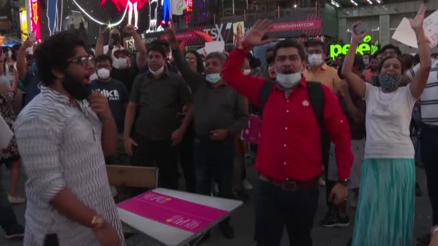 dozens converge to times square to celebrate the groundbreaking construction of a new hindu temple in india at a flashpoint religious site that has... - diminishing perspective stock videos & royalty-free footage