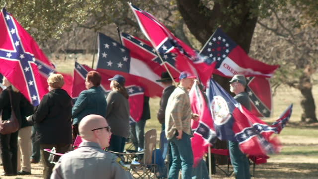 kfor dozens gathered in an oklahoma city metro park on the afternoon of march 3 in support and opposition for a confederate flag rally - confederate flag stock videos and b-roll footage