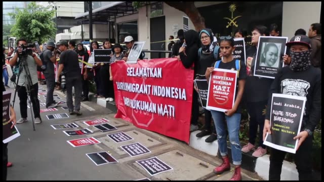 dozens of activists protest outside the saudi arabia embassy in jakarta on november 02 2018 after an indonesian domestic worker was executed by... - migrant worker stock videos and b-roll footage