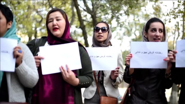 dozens of afghan activists protest in kabul to call for justice for a young woman stoned to death by militants after being accused of adultery in... - kabul stock videos & royalty-free footage