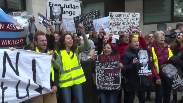 dozens of assange supporters including french yellow vests protest in front of the london court where wikileaks founder julian assange faces an... - capital letter stock videos & royalty-free footage