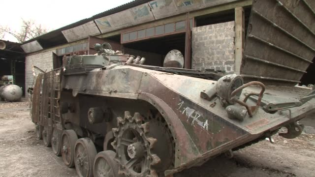 dozens of battered armoured vehicles howitzers and tanks are waiting for their turn to come back to life as the pro russian separatists in eastern... - ukraine stock videos & royalty-free footage