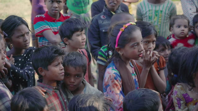 Dozens of children crowd around in Kutupalong refugee camp in Bangladesh Children make up over 50% of those in the camps and when walking through the...