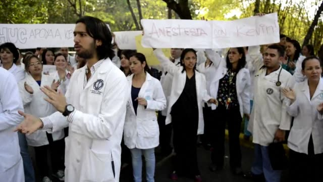 dozens of doctors and nurses staged a street protest tuesday outside a public hospital to demand better security after a medical resident was stabbed... - medical resident stock videos and b-roll footage