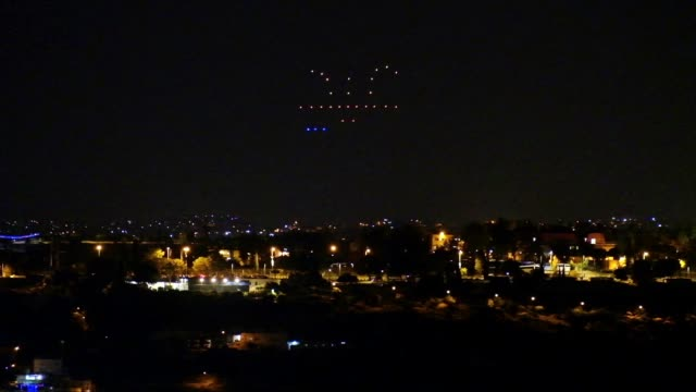 dozens of drones fly in formation spelling the arabic word eid in a light show above east jerusalem on 20th may 2020 to deliver a ramadan greeting... - east jerusalem stock videos & royalty-free footage