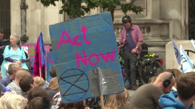 dozens of extinction rebellion activists demonstrate outside the royal court of justice in london to ask for ecocide to be recognised as a crime by... - scolding stock videos & royalty-free footage