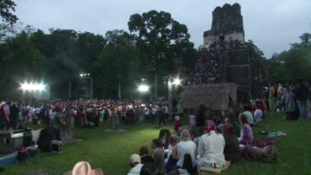 Dozens of Guatemalan Mayan priests watched by a few foreign tourists and doomsdayers perform traditional ceremonies at the first sunrise of the new...