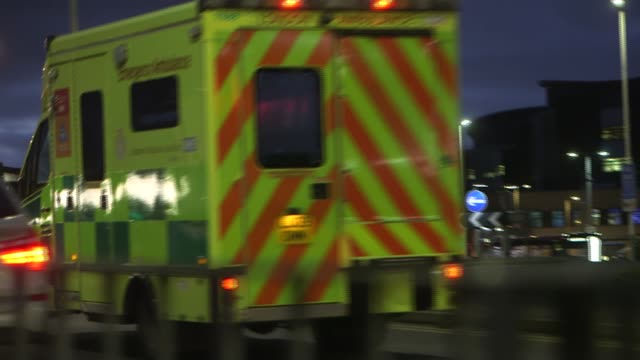 dozens of health service trusts report severe levels of risk england romford queen's hospital ambulance along speededup footage traffic round... - night stock videos & royalty-free footage