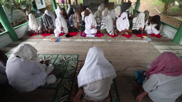 Dozens of Indonesian men follow the tradition of Suluk during the holy month of Ramadan in Aceh Indonesia Suluk is a way of remembrance of Allah used...
