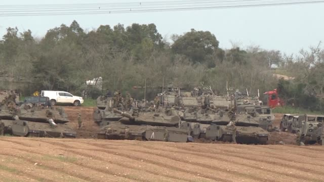 dozens of israeli tanks military vehicles and troops gather near the border with the gaza strip after a ceasefire announced by hamas to end another... - gaza strip stock videos & royalty-free footage