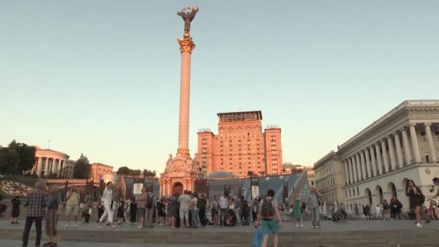 dozens of journalists descend upon the central square in kiev laughing hugging and quaffing sparkling wine as they celebrate the resurrection of... - critic stock videos & royalty-free footage