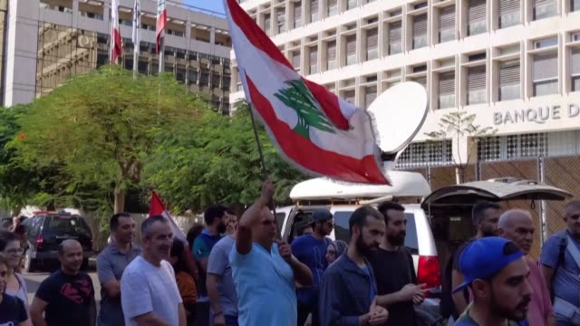 dozens of lebanese demonstrators gather in front of the central bank in beirut where they accused its chief riad salameh of worsening the country's... - lebanon country stock videos & royalty-free footage