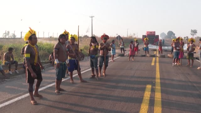 dozens of members of brazil's kayapo indigenous community block a major trans-amazonian road to protest against the lack of support given by jair... - major road video stock e b–roll