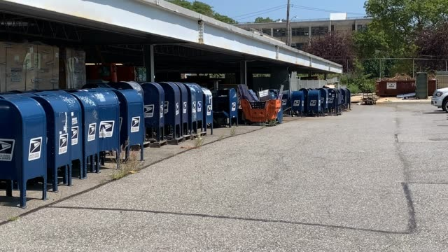 dozens of old blue usps mailboxes sit in the parking lot of a post office on lafayette avenue on august 17, 2020 in the bronx borough of new york... - letterbox stock videos & royalty-free footage