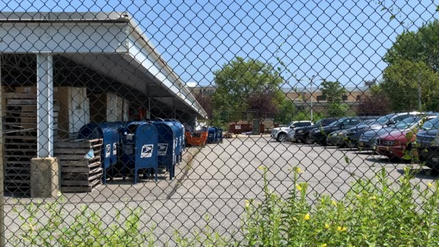 vídeos de stock, filmes e b-roll de dozens of old blue usps mailboxes sit in the parking lot of a post office on lafayette avenue on august 17, 2020 in the bronx borough of new york... - united states postal service