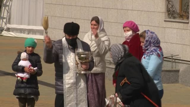 dozens of orthodox believers gather before minsk's churches to have their easter food blessed by holy water svetlana an 81yearold pensioner says it... - belarus stock videos & royalty-free footage