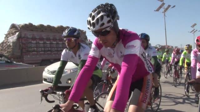 dozens of pakistani and afghan cyclists embark on a 350 kilometre race through pakistan's scenic but militancy-hit northwest to promote international... - kilometre stock videos & royalty-free footage