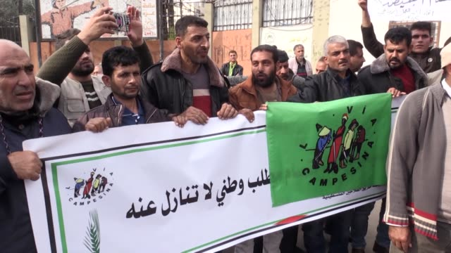 Dozens of Palestinian protesters take party in a rally to call for healing a decadelong division between rival groups Fatah and Hamas on December 03...