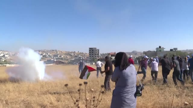 dozens of palestinians demonstrate near the palestinian village of beit sahur near bethlehem in the occupied west bank during a protest against the... - palestinian stock videos & royalty-free footage