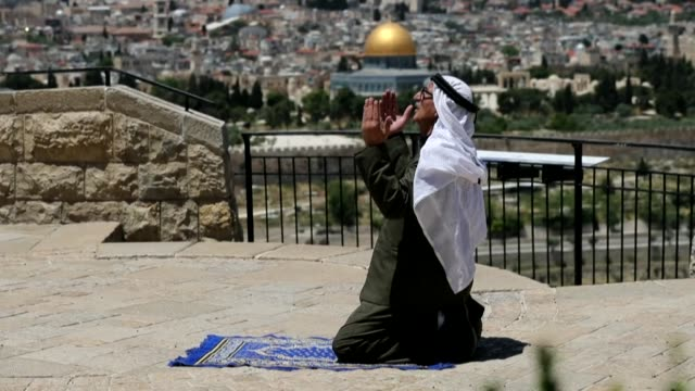 dozens of palestinians perform the third friday prayer of the muslim holy month of ramadan, at the mount of olives and in front of the entrance of... - jerusalem stock videos & royalty-free footage
